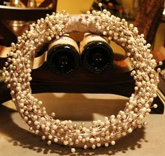 Pearl wreath door decorations http://themommyhoodproject.com/diy-christmas-a-gorgeous-pearl-wreath-for-your-front-door/