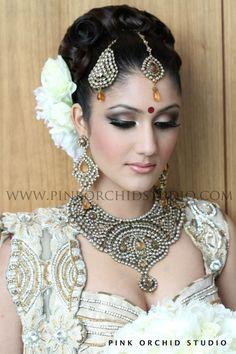 tikaa maang amber - pink orchid studio. More here: http://www.indianweddingsite.com/10-maang-tikka-jhoomar-looks/
