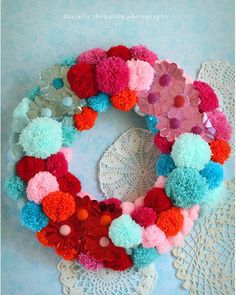 We love this colorful pom-pom wreath.