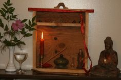 "Small shrine I made out of an old drawer turned on its side. The ""shelf"" is the drawer divider. #wiccan #pagan"