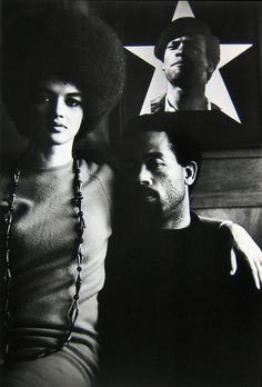 Eldridge and Kathleen Cleaver, in front of a  Huey Newton poster