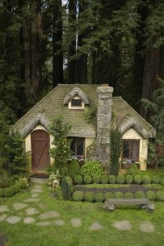 What fun inspiration for a hobbit cottage or garden playhouse. Love the little roundy boxwoods! Design by Robert Mahrer in Santa Cruz, CA.