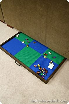 DIY lego tray-- slides under couch, can remove the lego boards and use it for other things as well.  Love.