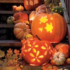 Cascading piles of pumpkins perfect for the front porch. Decorate a few here and there to illuminate the smaller pumpkins, gourds, and changing leaves of fall.