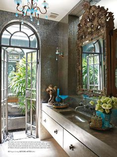 Turquoise chandelier & sconces, MIRROR... and everything else! Lovely.