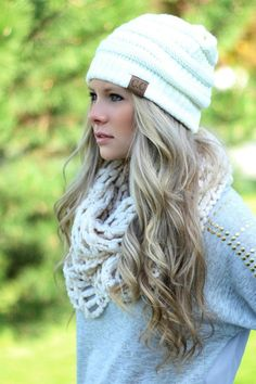 cozy outfit - beanie + cable knit scarf + sweater...and her hair...it's so pretty!