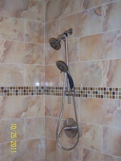 idea for the shower nightmare that is currently being worked on- Double shower head. For a tall + short couple