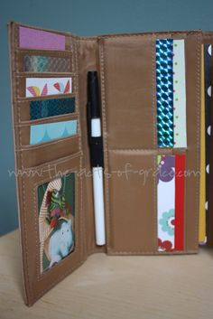 This busy wallet is GENIUS!  Especially for the kids at the restaurant while you're waiting for your food: Pick up a cheap wallet. fill it with pictures, scrap paper, stickers, and various treasures.