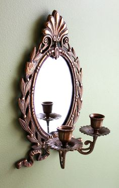 Wall Candleholder with Oval Mirror.  Wall by AnythingDiscovered, $42.00 - I would paint this all black for my living room.  ~Vanessa N. Moylan