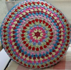 Round Granny Cushion by Moogsmum using Mandala pattern from Crochet with Raymond here: http://crochethealingandraymond.wordpress.com/2010/11/11/revisiting-the-granny-mandala/