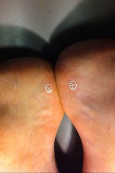Small white foot tattoos