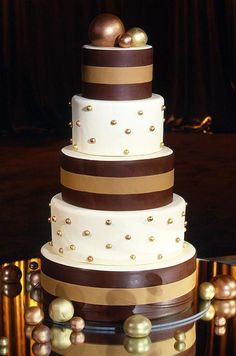 Masculine and feminine elements combine with this sharp brown and white cake, complete with light brown ribbon and gold and copper pearls.