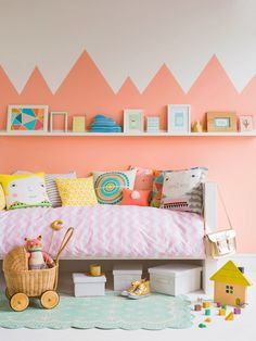 Bright, cozy kid space with Coral walls
