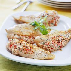 feta stuffed chicken--Cut into one of these succulent chicken pieces and you'll discover a zesty feta cheese, tomato, and basil filling. It's a surprising low-caloire, low-fat option for dinner.