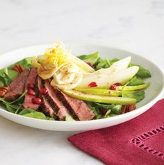 Steak and Pear Salad is as beautiful as it is delicious! The pomegranate seeds look like little hearts adorning each salad.