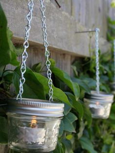 With just a couple hardware-store staples and some inexpensive mini mason jars, you can whip up a slew of charming candle holders to surround your space. garden light, mason jar crafts, mason jar candles, backyard, mason jars, mini mason, tea lights