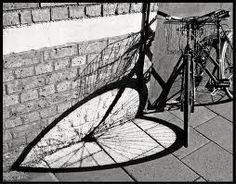 photo of a bike wheel shadow heart