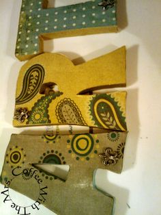 decorated wooden letters using scrapbooking paper