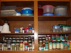 Organized spices in cabinet on stair step organizer {featured on Home Storage Solutions 101}