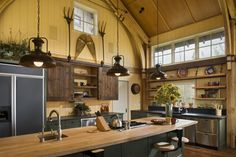 A bit rustic and a bit modern in this Wyoming timber frame home kitchen