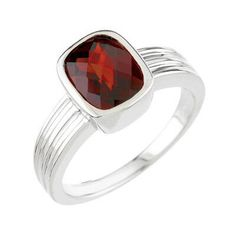 This Garnet Ring showcases a checkerboard 9X7mm Cushion cut Faceted Garnet Gemstone in a bezel set Ring 14K White Gold mounting. The gemstone set in this Garnet ring is a Genuine AA Quality Mozambique Dark Orange Red Garnet