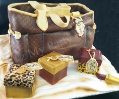 Louis Vouitton Purse Cake W/ Sugar Boxes - Yellow Cake w/ IBC.  Boxes are made from sugar paste and handpainted.  Lipstick is fondant.