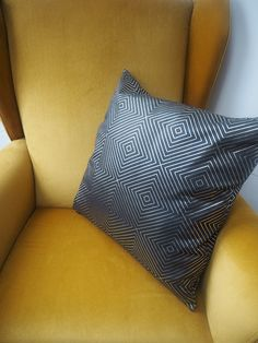 Gray and gold cushio