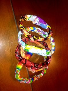 Duck tape bracelets  Take a piece of Duck tape and file it in half Cut down the middle to get two pieces and do this two more times.  Will give you 4 strands but you can save the other one for another time Braid the three strands together, the tighter huge better Wrap around to fit desired length for wrist an then take another small piece of duck tape to hold together  Great fashion piece or gift