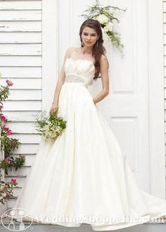 Pockets, a cool crumb neckline and amazing beaded motif at waist in this Watters Houston wedding dress