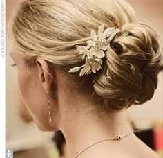 A beautiful, ivory, enamel hair comb with two flowers and Swarovski crystals accented the low, loosely gathered bun. hair clips, bridesmaid hairdos, romantic hair, hair pieces, messy buns, swarovski crystals, wedding hairstyles, hair buns, hair combs