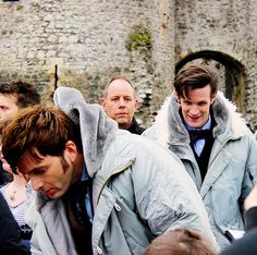 David Tennant and Matt Smith signing autographs on the set of Doctor Who. (In matching parkas!)