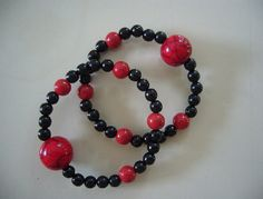 "Queasy Beads Motion Sickness Bracelets in ""Dramatic Red & Black"" by QueasyBeads, $19.95"
