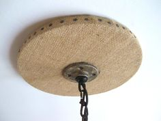 DIY Burlap covered chandelier canopy / light fixture medallion / ceiling medallion… Whatever you call it - it is industrial farmhouse chic!