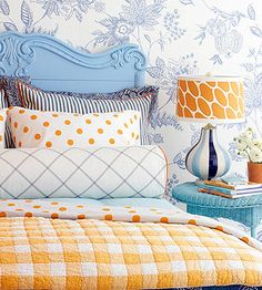 I love this combination of colors and patterns. This would be a cute guest room.