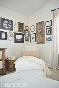 DIY corner gallery wall {how to create a gallery wall with no holes in the wall!!} - lizmarieblog.com