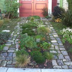 a garden driveway, what are those blocks?  nice materials and house colors
