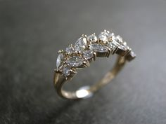Marquise Diamond Wedding Ring via Etsy. Flat engagement ring= ring won't spin on finger and drive you crazy