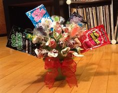 """Work Blows, Retirement Rocks!""  Retirement gift I made for a co-worker.  Blow Pops, Pop Rocks, and Rock Candy Sucker Bouquet."
