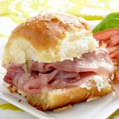 Ham Tailgate Sandwich Recipe 1 pkg. (12 count) Hawaiian bread rolls 1 lb. shaved Black Forest ham 12 slices Gruyere cheese 1 tub (8 oz.) Philadelphia® Chive & Onion Cheese Spread 1/2 cup butter, melted 1 Tbsp. Worcestershire sauce 1/2 Tbsp. dried minced onion 1/4 cup grated Parmesan cheese