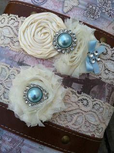 ivory / creme wedding garter / bridal  garter/  lace garter / toss garter / Something BLue wedding garter / vintage inspired lace garter. $28.99, via Etsy.