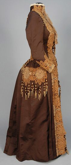 LOT 593 SILK AT HOME DRESS with LACE APPLIQUE and TASSELS, 1880s. - whitakerauction