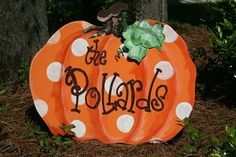 buy a metal pumpkin at hobby lobby, add white polka dots and personalize!