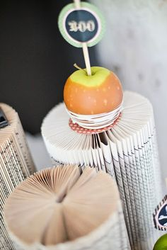 Folded books as halloween decor! Haunted Halloween Party via Kara's Party Ideas - The Place for All Things Party! #halloweenparty