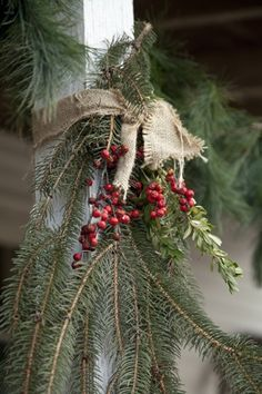 Christmas greenery tied to porch post
