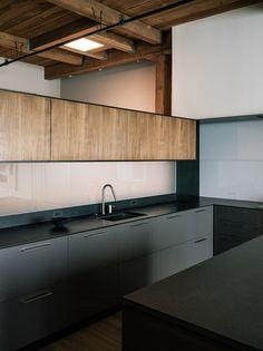 Black + natural wood cabinets