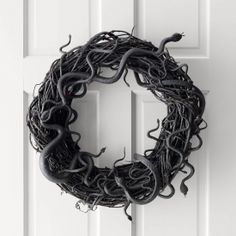 Scare the pants off anyone who comes to your door this Halloween with this Snake Wreath DIY!
