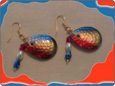 http://diginanchors.com/EarringsAlure_CrystalBearded - Costume jewelry made with fishing lures that is stamped out of pure brass & carefully hand painted. America The Beautiful earrings are beautifully painted red, gold & blue with an eye added to give it an eye catching apperance. The back blade is overlaid with 22k gold. Elegant red and white beads along with sparkling blue tear drop crystals are added to create the fine jewelry for EarringsAlure.com. They are 2 inches long & 3/4 inch wide.