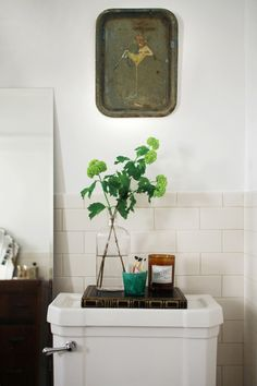 A little vignette over the toilet feels luxurious in a small bathroom.