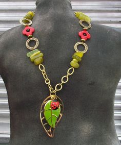 Unique statement piece necklace, gold chain, green leaf with ladybug pendant and free matching earrings. $25.00, via Etsy.