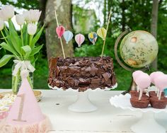 chocolate cake with bunting. Love the tiny hot air balloons!